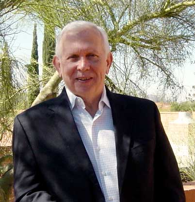 Chuck Haug in his back yard in Tucson Arizona, retail store closing consultant